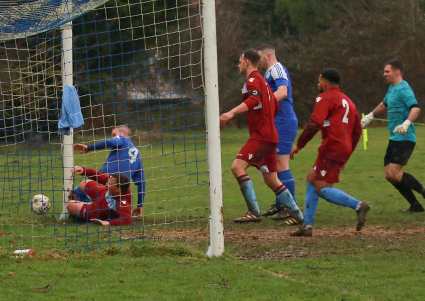 ON TARGET: Adam Solley forces the ball over the line to make it 2-1 to Hoxne, but they ended up being well beaten