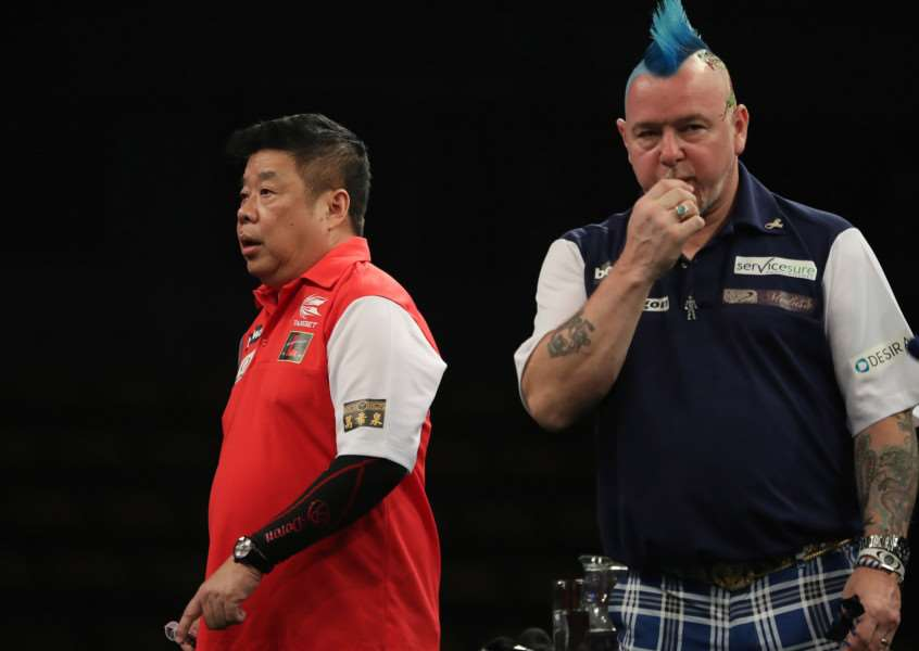 SHOCK DEFEAT: Peter Wright's Scotland lost in the first round Picture: Lawrence Lustig/PDC