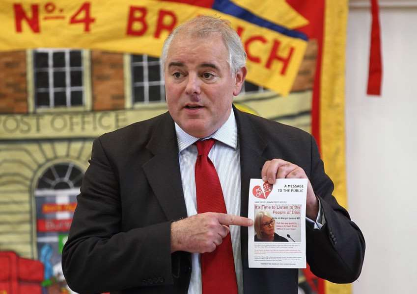 Richard Bacon, former MP and current Conservative parliamentary candidate for South Norfolk, addresses Diss residents at a public meeting about the future of the town's Crown Post Office. Photo credit: John Bulloch.