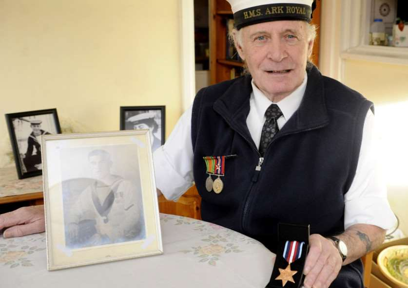 Billie Stannard, with the Arctic Star Medal awarded to his late father, T.E Stannard for his service.