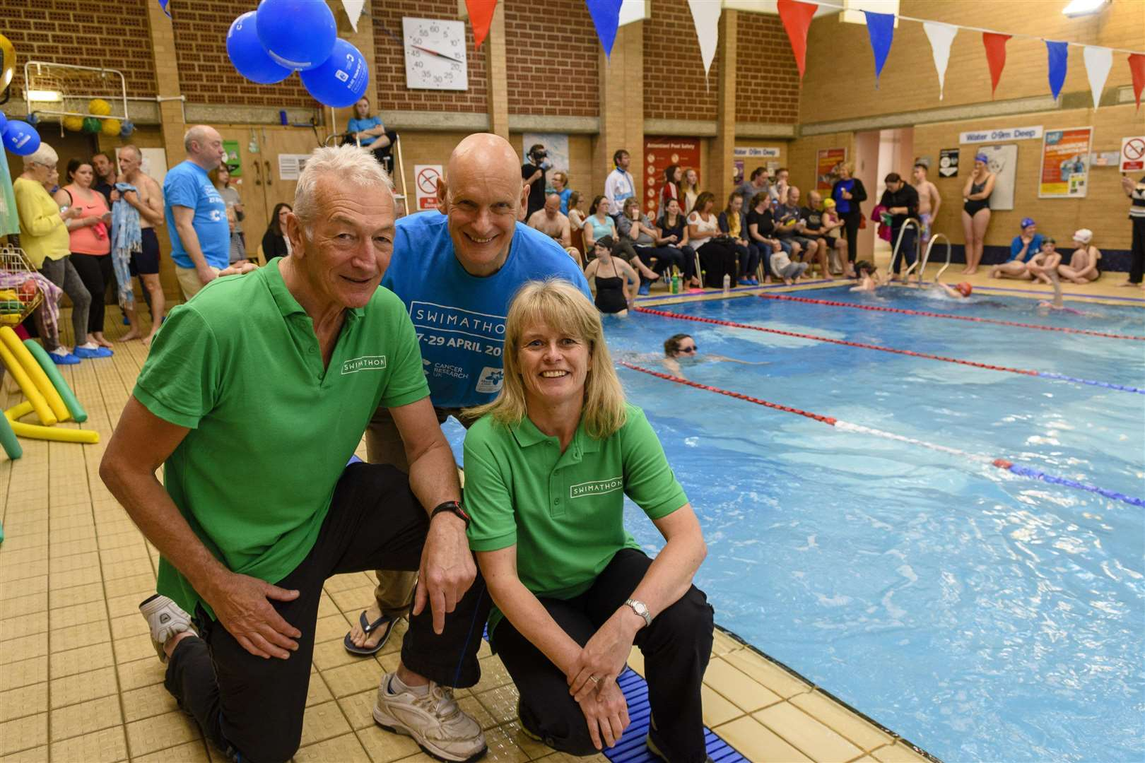 Stradbroke, Suffolk. Swimathon at Stradbroke swimming pool with over 200 swimmers taking part with Duncan Goodhew making a special appearance. Pictured are Len Phoenix, Duncan Goodhew and Maria Smith. Picture: Mark Bullimore Photography (1978630)
