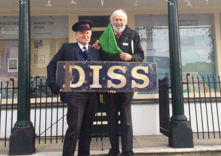 Dave Deane (right), supervisor at Diss railway station, with Basil Abbott (left) of Diss Museum on the acquisition of an old station sign. Submitted picture.
