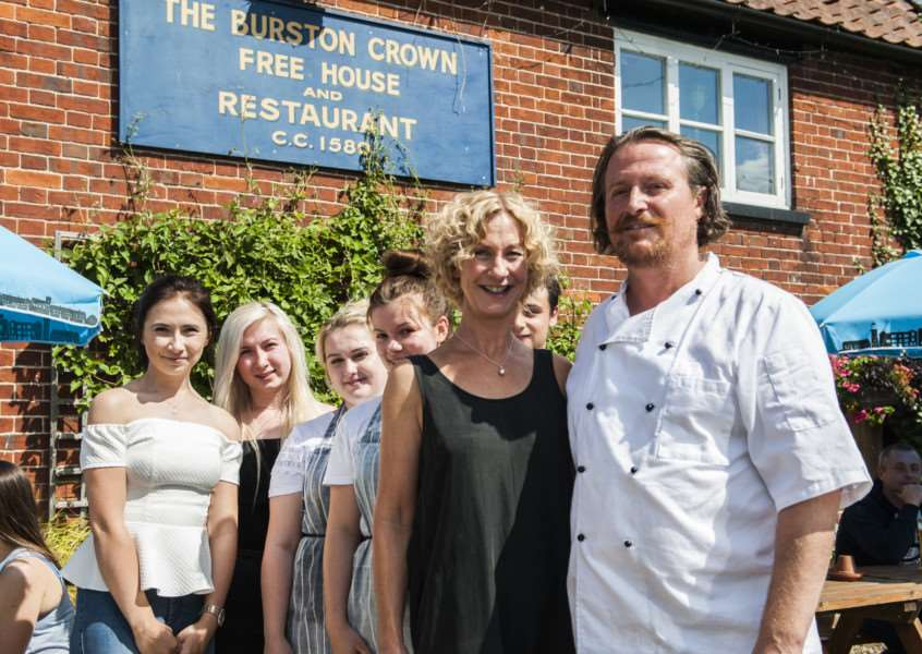 Bev and Steve Kembery of The Burston Crown pub. They are pictured with their staff.