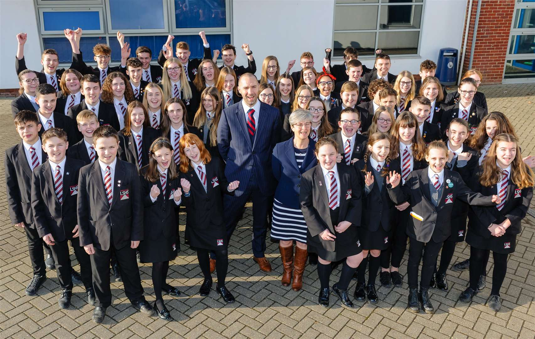 REASON TO CELEBRATE: Pupils and staff at Long Stratton High School celebrate their success.