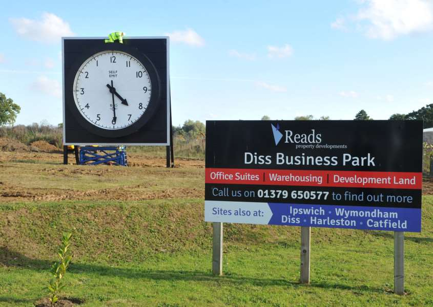 Giant clock at the entrance to Diss Business Park ANL-150930-114352009