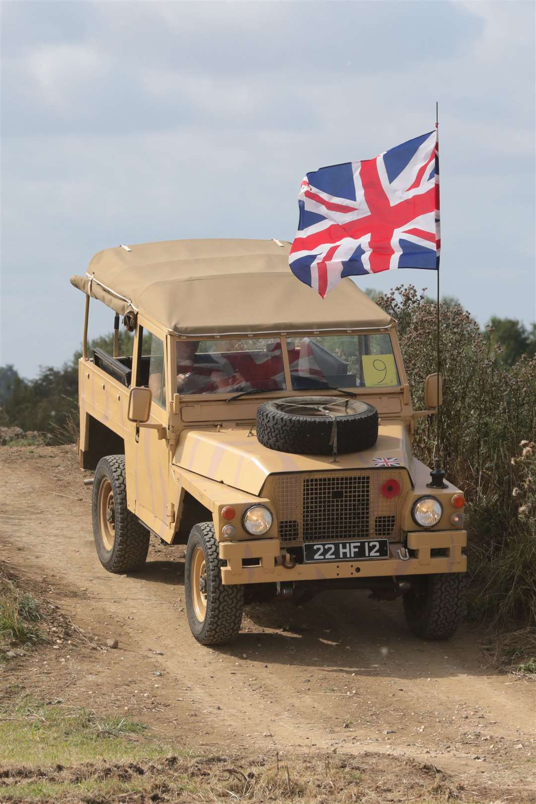 A military vehicle flies the flag