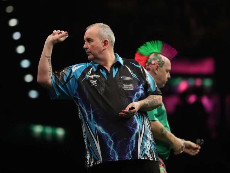 GOING DOWN: Phil 'The Power' Taylor was on the end of Peter 'Snakebite' Wright's venom Pictrue: Lawrence Lustig/PDC