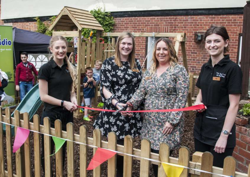 The Bell Inn in Rickinghall is celebrating one year in business after re-opening under its current management. They will be opened a new play area at the pub, with management and staff at the ribbon cutting.