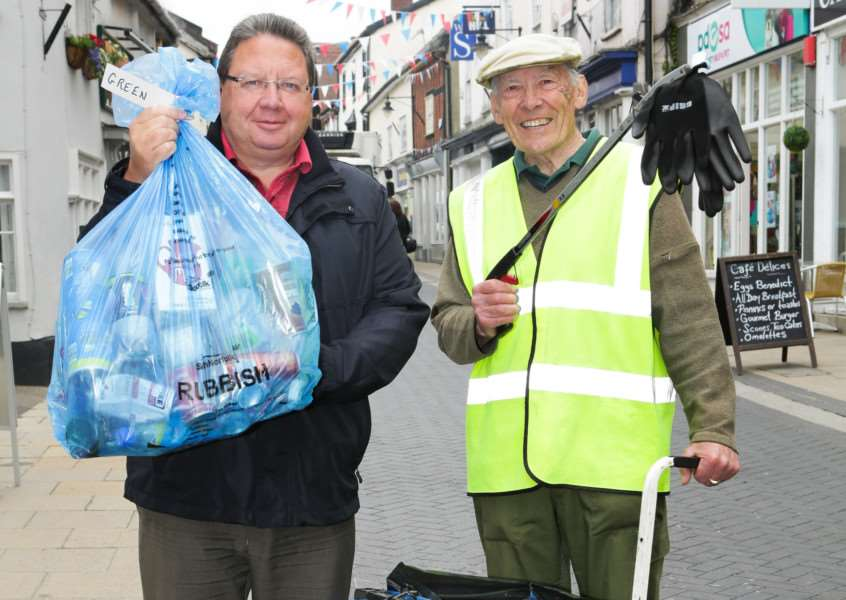 Retired 77-year-old pensioner Billy Turner helps to collect litter in Diss High Street with Rickinghall business owner Peter George. Picture submitted.