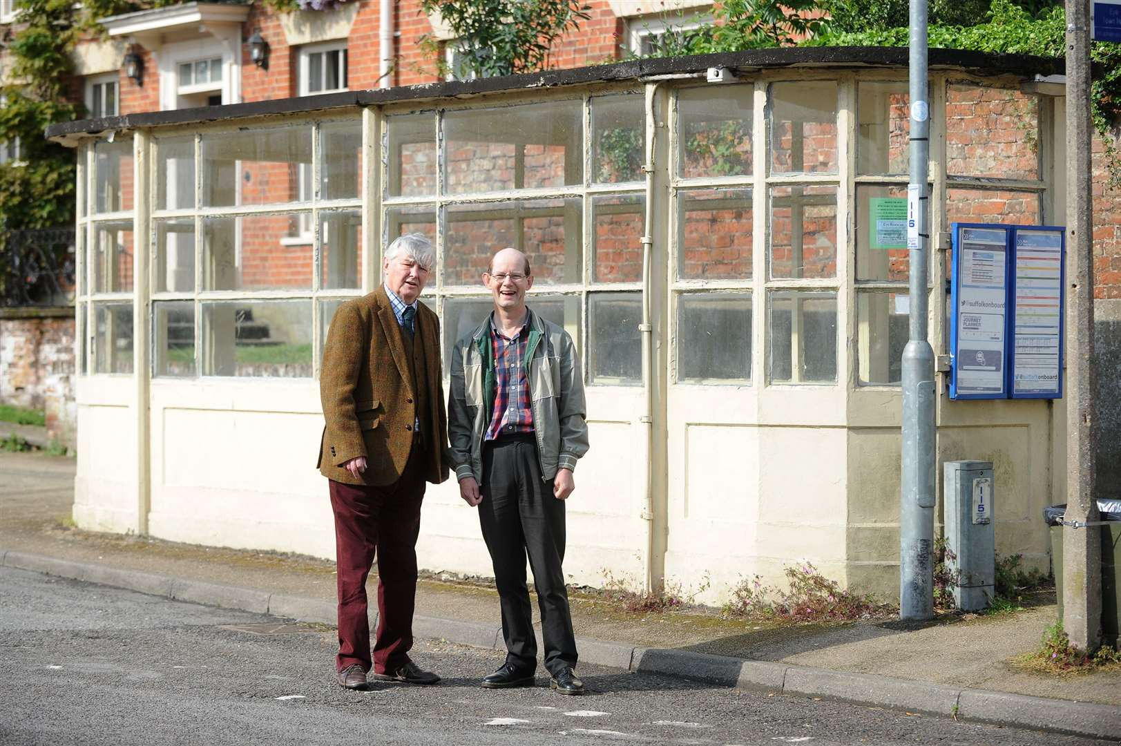 Guy McGregor and Patrick Burnside outside the bus shelter, which is due to be restored. Picture by Mecha Morton.