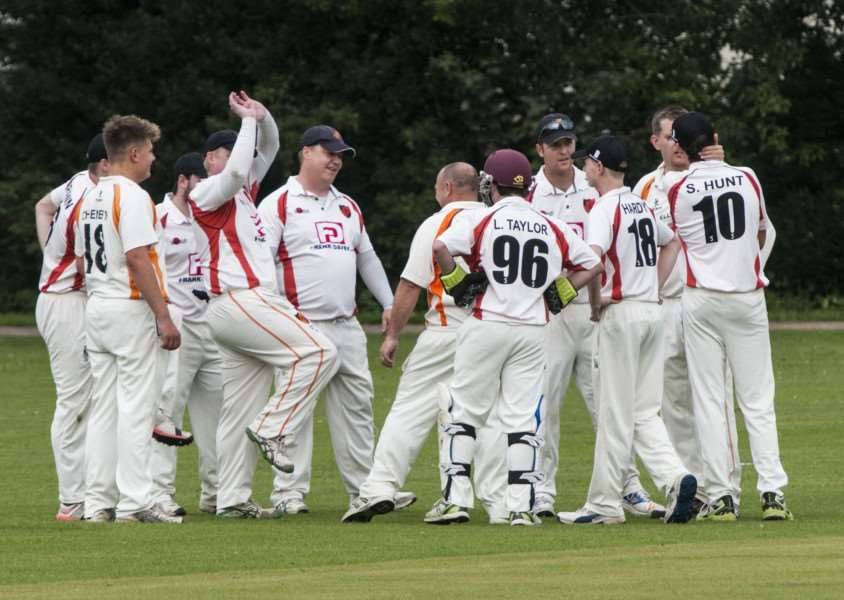 GOING UP: Diss celebrate taking a Lowestoft wicket