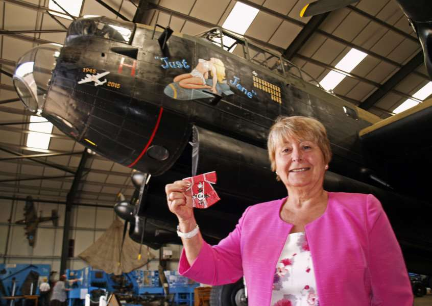 Carol Wiles MBE, of Harleston, in front of an Avro Lancaster. ANL-160206-102119001