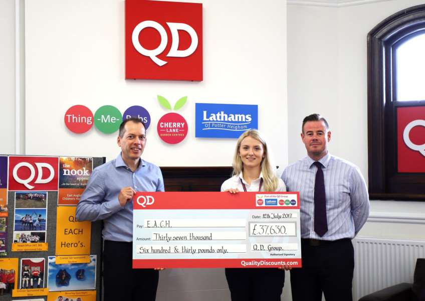 A cheque for �37,630 was presented to EACH Fundraiser Sophie Mayes by Associate Director of Trading James Collins and Co-ordinator David George from QD Stores. Submitted picture.