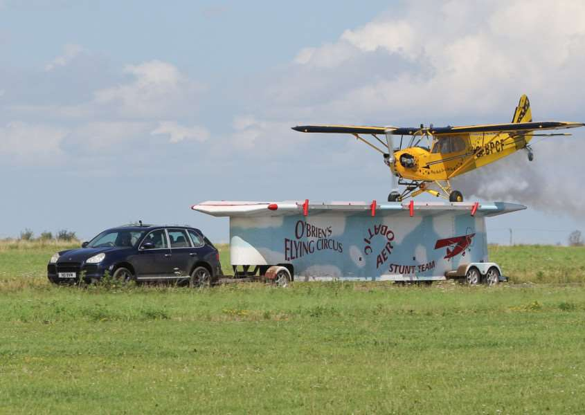 MDEP-30-07-2017-016 Old Buckenham Airshow,TV presenter and Flying legend Brendan O'Brien lands his Piper Cub on a trailer at 60MPH.