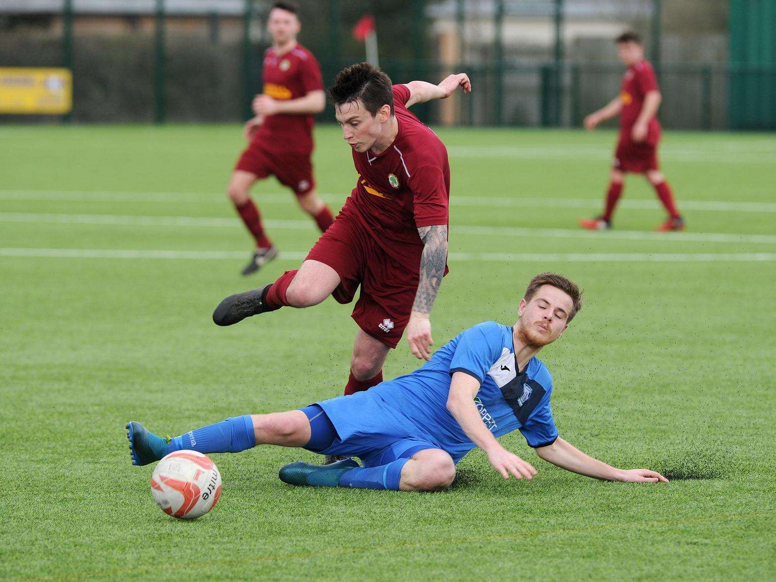 SLIDING IN: Haverhill Borough's Ryan Swallow tackles Walsham's Niall McPhillips. Picture: Mecha Morton