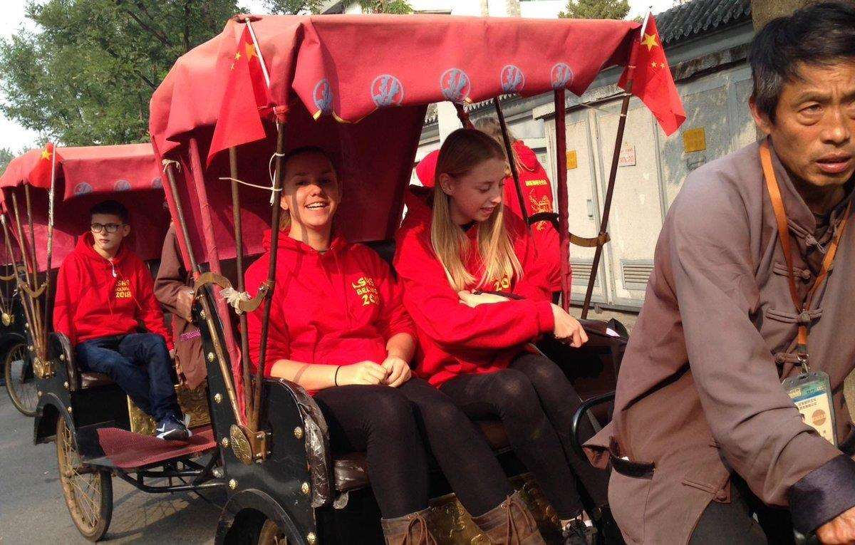 The students enjoyed a ride in the old fashioned passenger cart called rickshaw.