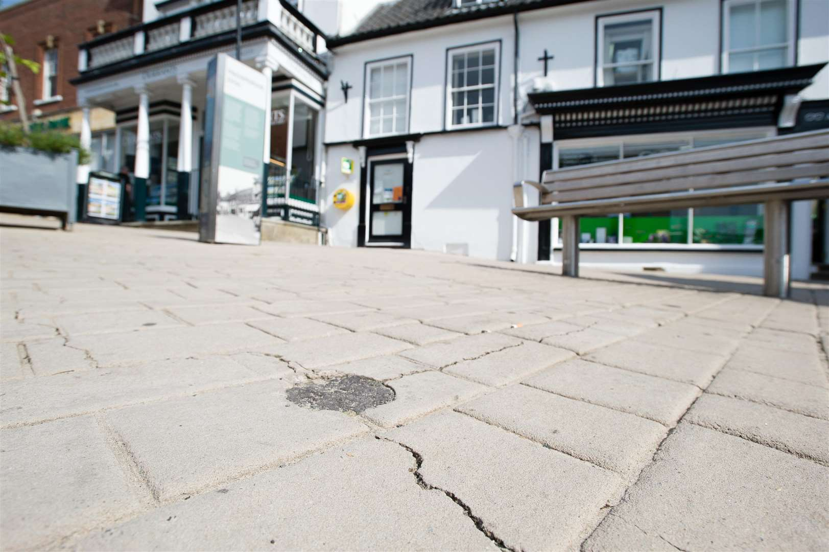 Cracks in the pavement on Market Hill in Diss.