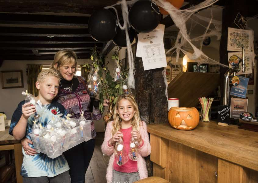 Donna Potter has made soldiers from pegs to raise awareness of Remembrance time. Pictured in the Queens Head pub, with her kids Mason and Amelia. ANL-150111-122928005