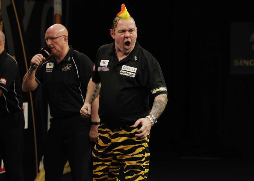 WINNING RUN: Peter Wright won eight legs in a row to beat Darryl Fitton 10-3 PICTURE: LAWRENCE LUSTIG/PDC