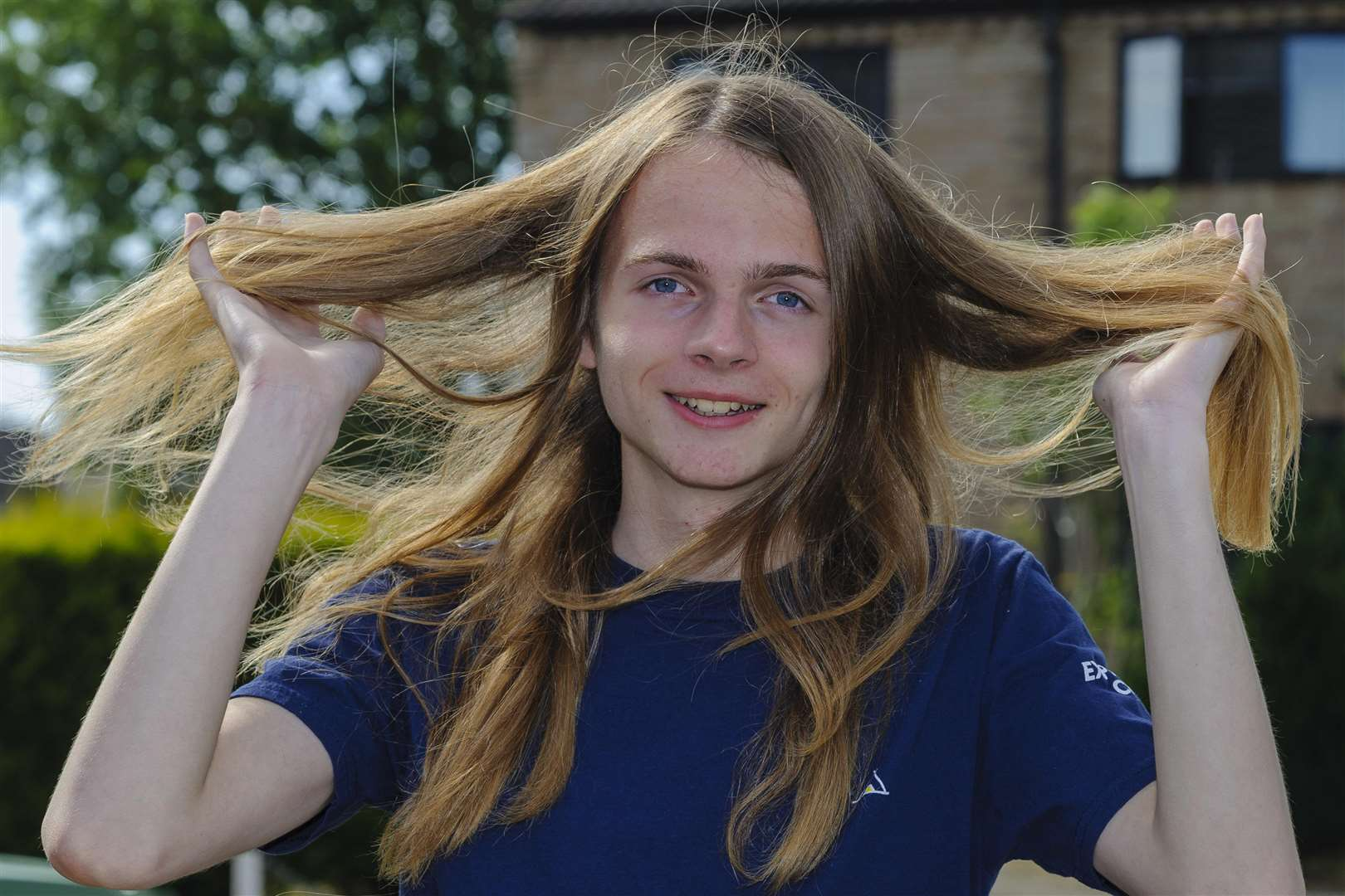 Evan Voyce, who's having his hair cut to raise money for a trip to Kenya. Picture by Mark Bullimore