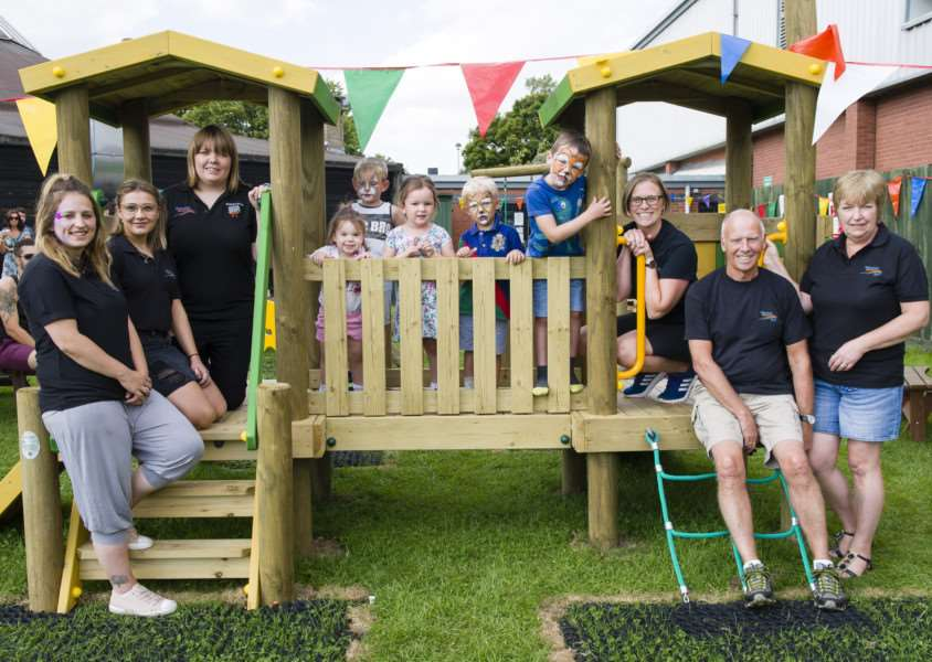 Debenham, Suffolk. Following a successful application to the Big Lottery Fund, a new play area and trim trail is officially opening in Debenham at the Leisure Centre. Staff of the leisure centre and children celebrate the opening of the new play equipment. ''Picture: MARK BULLIMORE