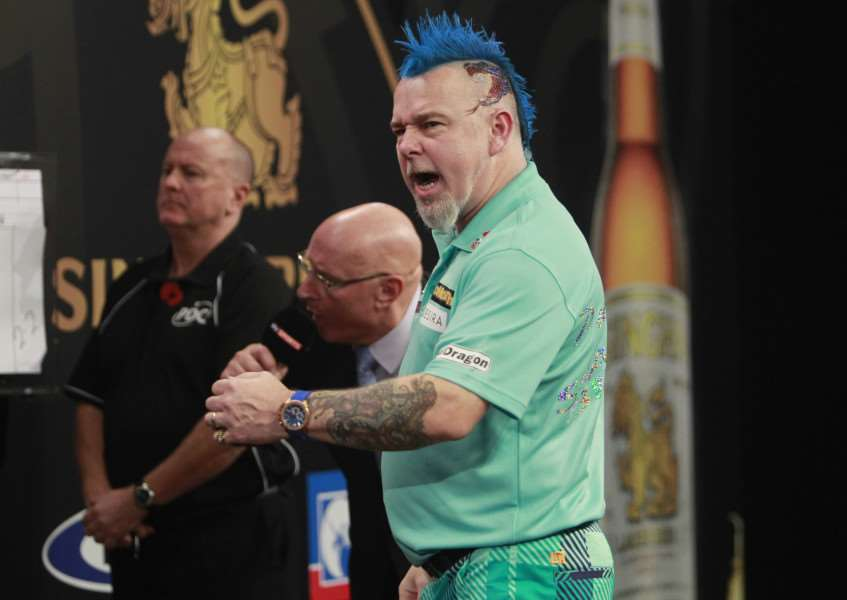 SHEER DELIGHT: Peter 'Snakebite' Wright roars with joy during his 5-3 victory over Mervyn King