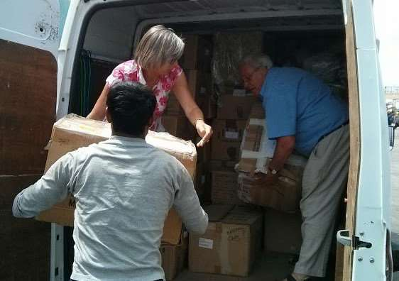 Sue Flagg loading a van of supplies for refugees after the last fundraising event.