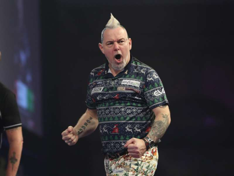 BACK IN ACTION: Peter Wright recovered from illness to take his place in this year's championships picture: Lawrence Lustig/PDC