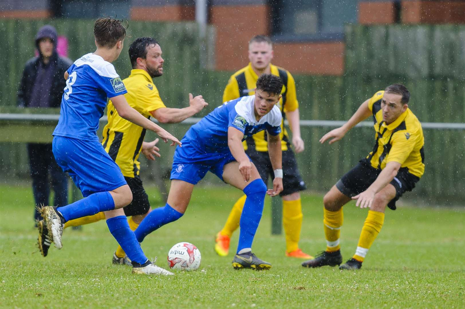 Football action from Debenham LC v Bury Town..Debenham players LEFT TO RIGHT – KEVIN BARKER, MAX HUTCHINGS, MICHAEL VELZIAN..Picture: Mark Bullimore Photography. (13683638)