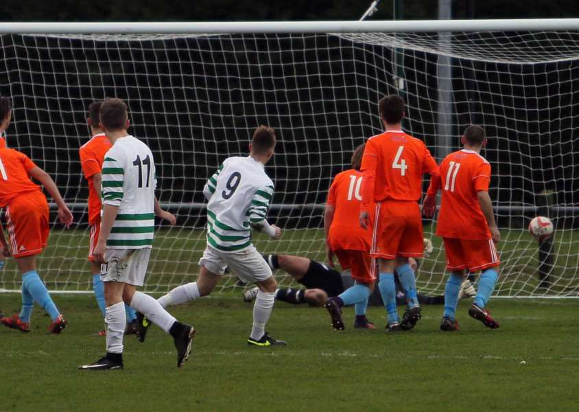 TOP FORM: Danny Smith (9) finds the net for Framlingham. Picture: Dean Warner
