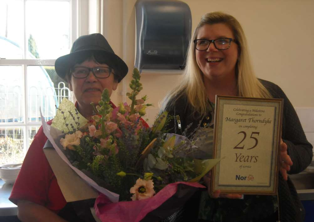 Margaret Thorndyke is presented with flowers and a certificate to mark her 25 years service to Hapton CE VA Primary School as a dinner lady ANL-150218-141703001