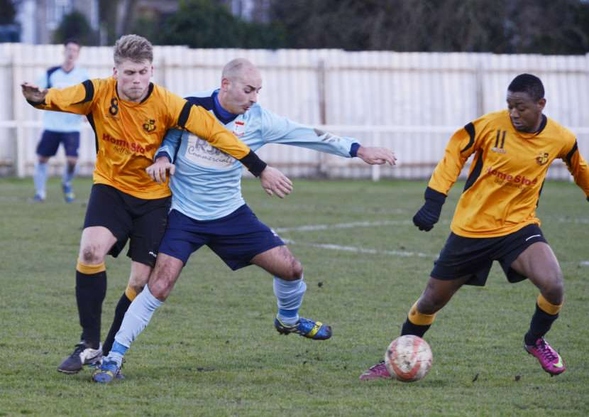 KEEP BALL: Diss' Danny Self battles for possession during the 2-2 draw with Mildenhall Town