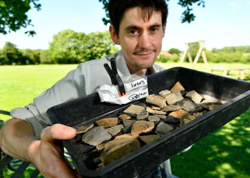 Tasburgh, Norfolk. Tasburgh Discovery Day, to reveal findings from the recent community archaeological digs around the village in April this year. Pictured is Giles Emery of Norvic Archaeology and some of the various pieces of medieval pottery found at the sites. Picture: MARK BULLIMORE