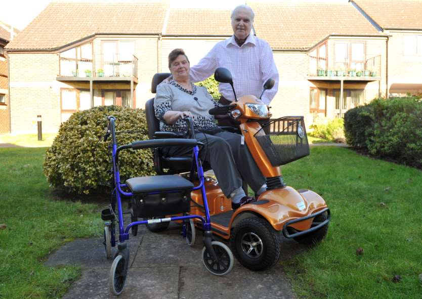 Jean Brewer-Mitchell had her mobility buggy and walker damaged beyond use after two separate instances of vandalism in one week ''Pictured: Jean with husband Gordon ANL-150218-124907009