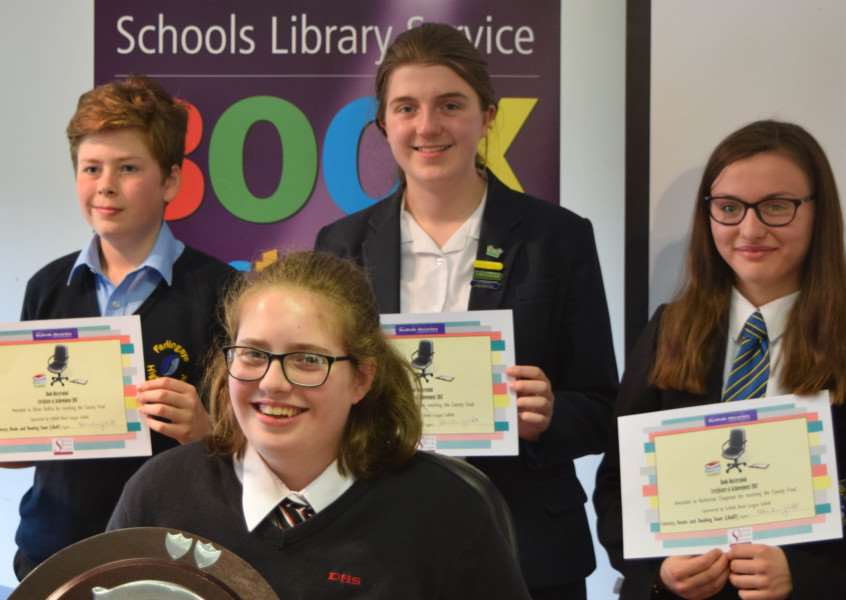 Emma Burley from Debenham High School with her winner's trophy, along with the finalists from other schools in Suffolk.
