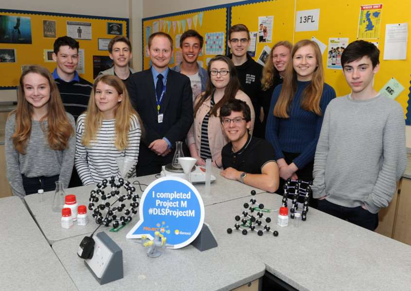 Year 12 Chemistry students at Diss High School have contributed samples towards a major experiment by leading UK science facility Diamond Light Source. Pictured: Students and Francis Lemon, Head of Chemistry. PICTURE: Mecha Morton