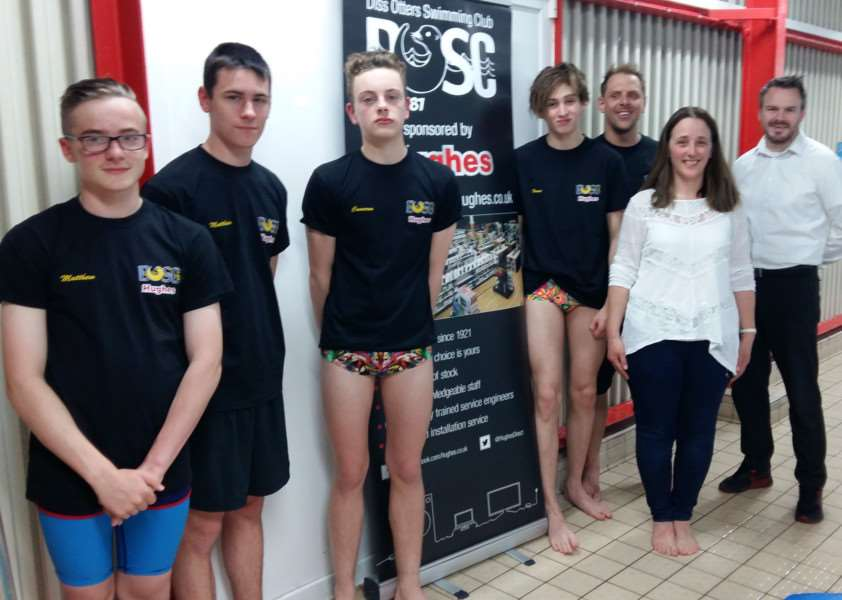 GOOD EFFORT: Diss Otters swimmers with head coach Jamie Rush, club chair Juliet Grimes and club sponsor Matthew Moss from Hughes