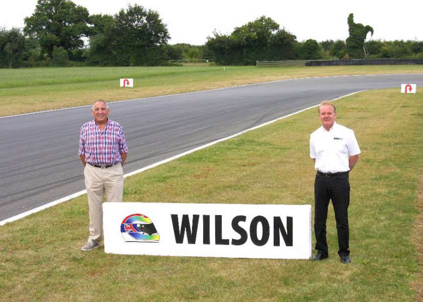 Keith Wilson (left), father of Justin, and circuit owner MSV's Chief Executive, Jonathan Palmer, and the newly christened corner at Snetterton ANL-160726-155553001