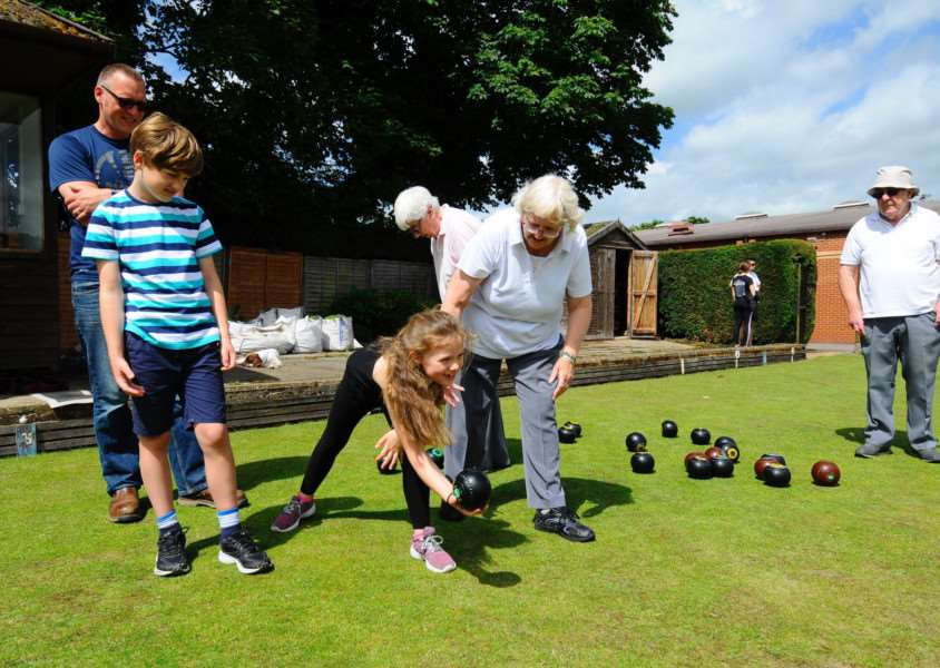 FAMILY FUN: Youngsters try out bowls during the Sports Open Day