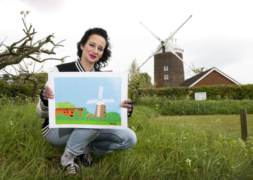 National Express Colour the Coach competition.' 'Artist Ruth Knapp and daughter Laila at Old Buckenham windmill with their paintings of the mill.' 'Credit: Adrian Judd