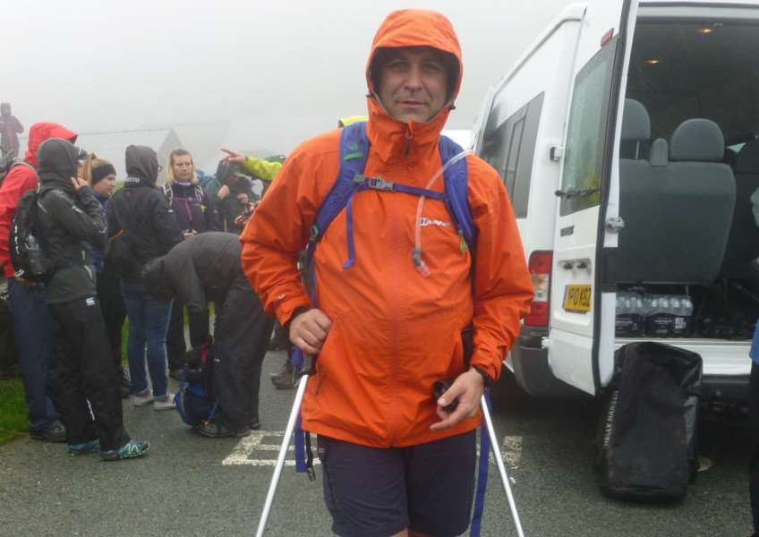 Dr Martin Sulo, of Botesdale Dental Practice, atop Ben Nevis, on his journey to complete the Three Peaks Challenge.
