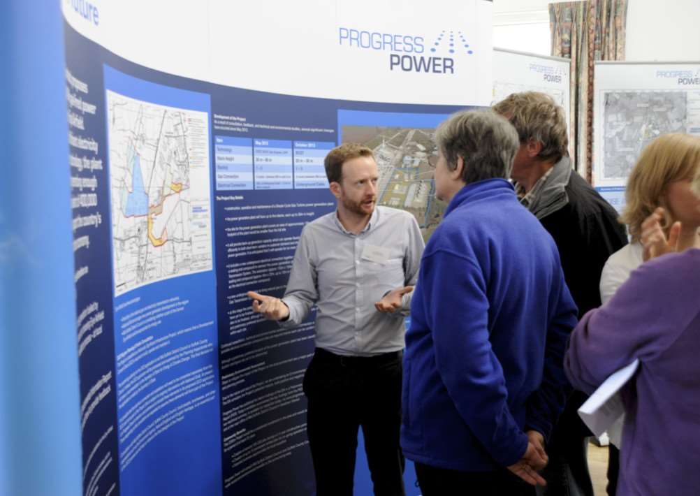 Mellis, Suffolk. Consultation about the proposed power station for Eye Industrial Estate at Mellis Village Hall pictured is CHris Leach talking to Sue and Kevin Brudenell ENGANL00120131014123231