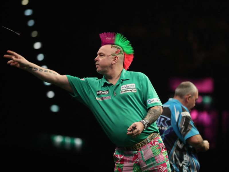 COOL CUSTOMER: Peter Wright aims high against Phil Taylor Picture: Lawrence Lustig/PDC