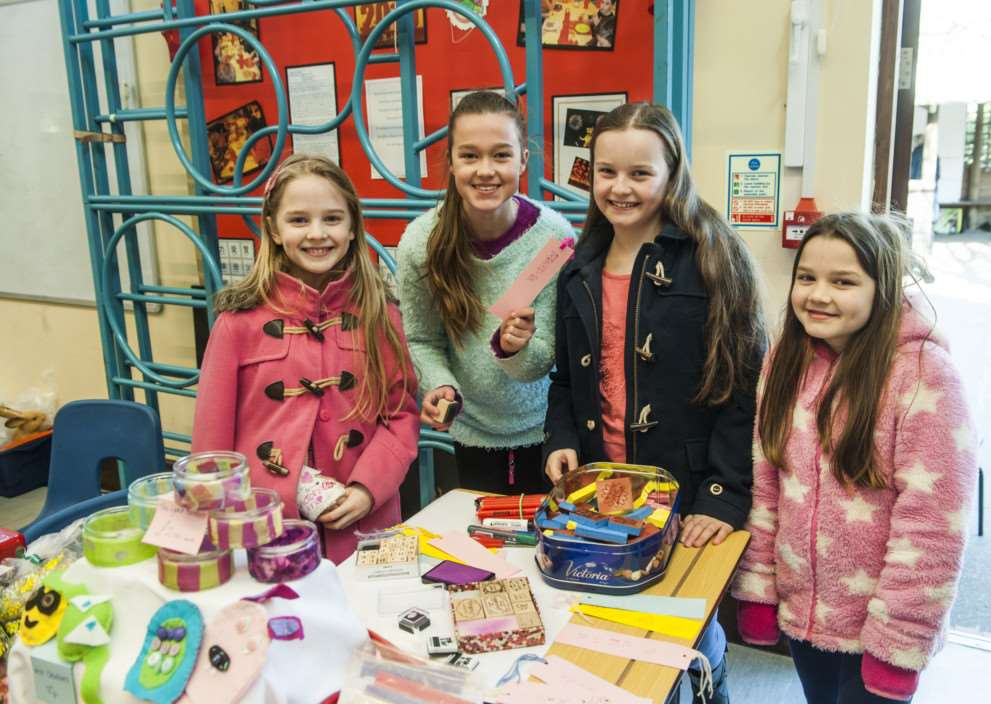 St Edmunds Primary School Hoxne, spring fair. Pupils sell crafts. ANL-150315-161658006