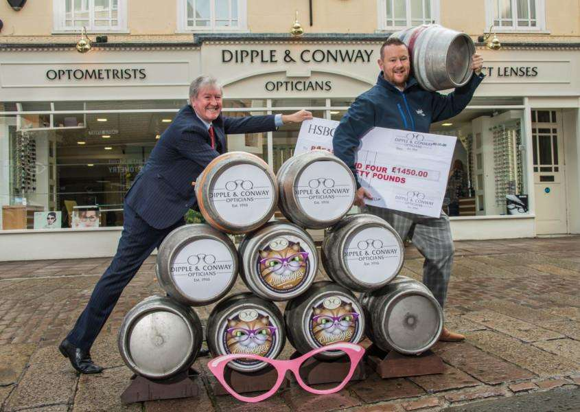 Damian Conway, Director of Dipple and Conway Opticians (left), celebrates the success of Cat's Eyes ale with Martin Green, Fundraising Manager of children's charity Break. Picture: Newsmakers.