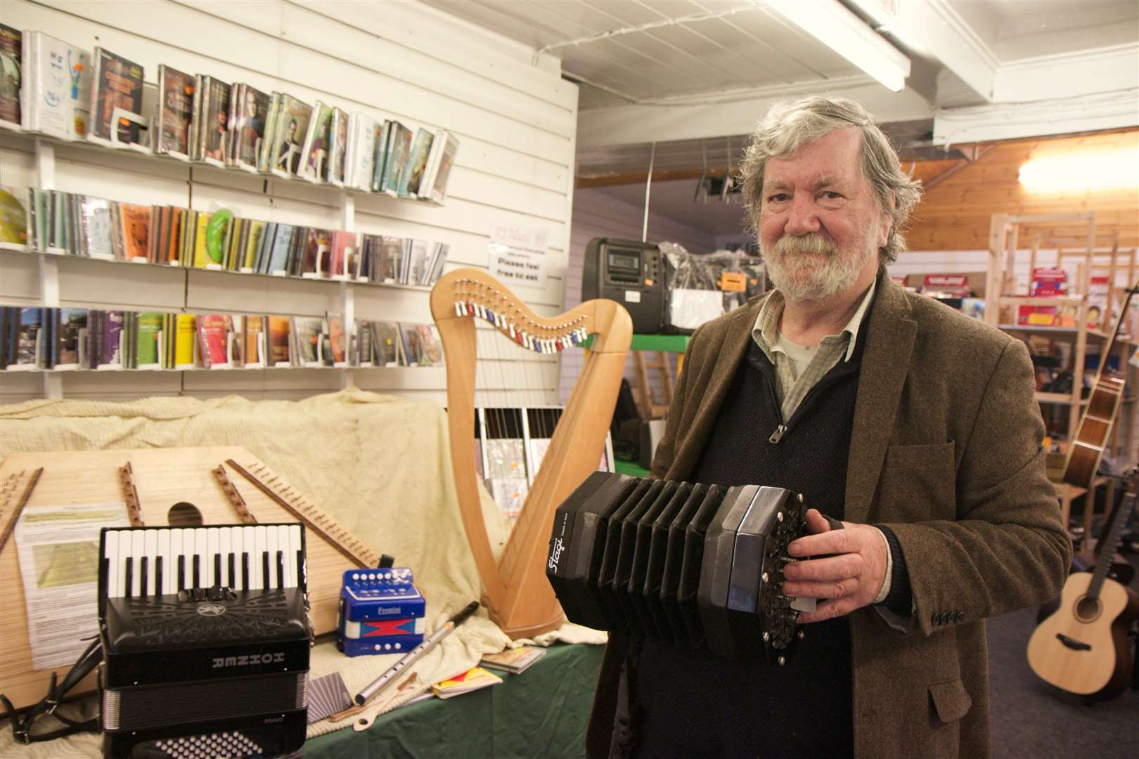 Squeezy does it: Pete Cunningham at his pop-up shop in Diss with a selection of some of his more rare instruments.