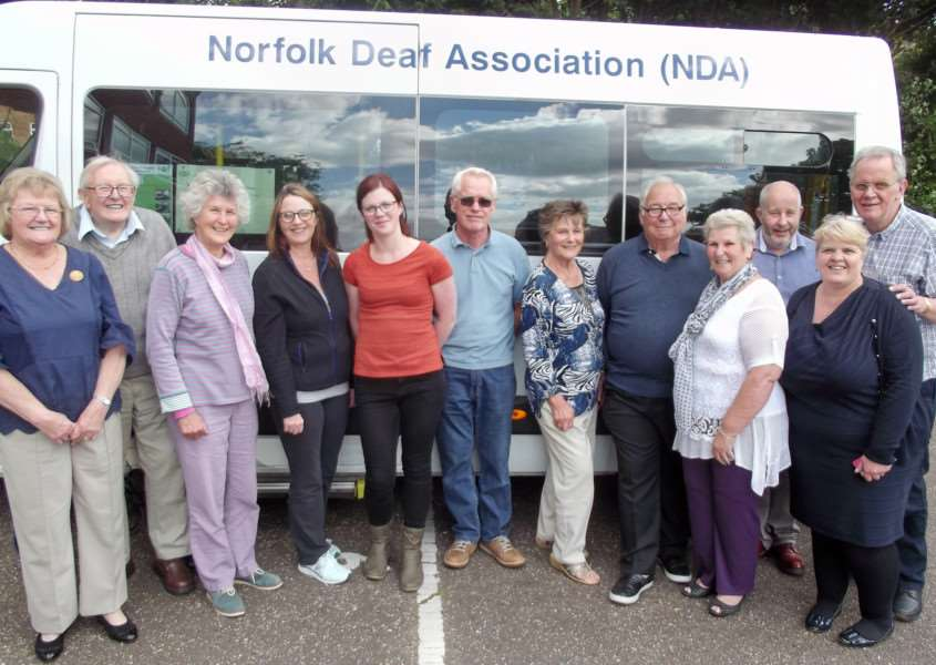 Norfolk Deaf Association volunteers in front of the mobile clinic minibus. Submitted picture.