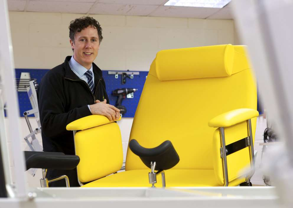 Wethringsett, Suffolk. Niall Dyer, MD of Plinth 2000 with the newley designed Bariatric Gynaecolgy Chair which is able to seat women upto 350kg during childbirth ANL-141119-143421001