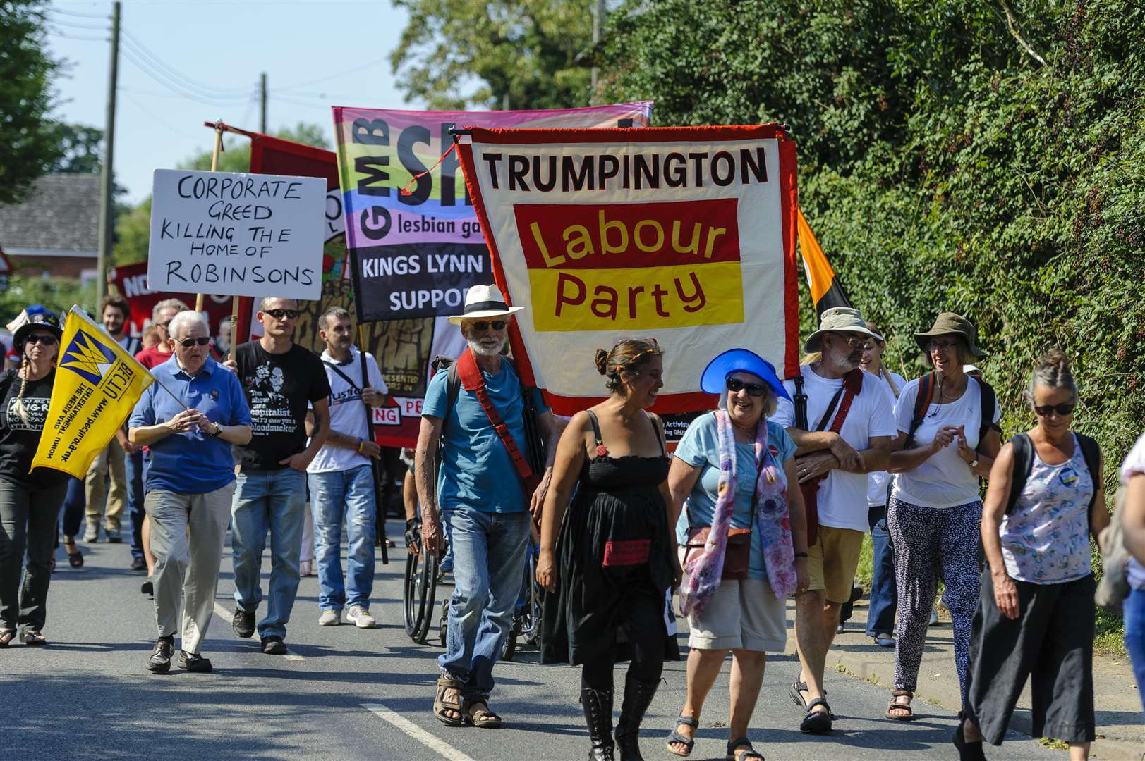 Burston Strike Rally to marks the longest strike in history. The march makes it way around the village. Picture by Mark Bullimore Photography.