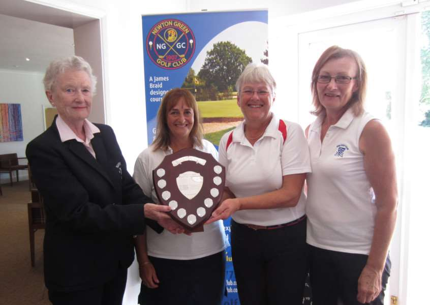 CHAMPIONS: Diss' Becky Draper, Philippa Bridges and Jenny Chamberlin pick up their trophy